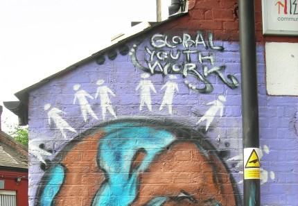 """Wall mural reading """"Global Youth Work"""""""